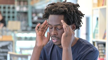 Portrait of Stressful African Man with Headache