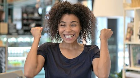 Successful Young African Woman Celebrating, Joy