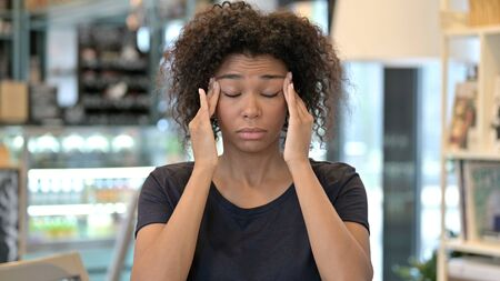 Stressed Young African Woman Having Headache