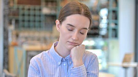 Portrait of Sleepy Young Woman taking Nap