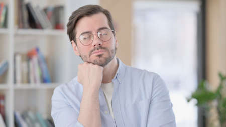 Portrait of Sleepy Man in Glasses Taking Nap