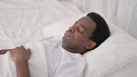 Peaceful African Man Sleeping in Bed