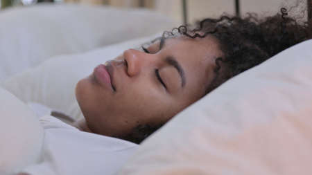 Close up of African Woman Sleeping in Bed