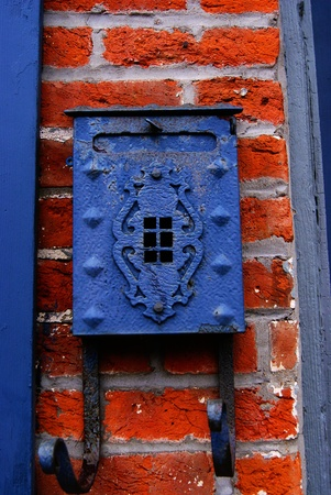 Old fashioned letterbox on a brick wall