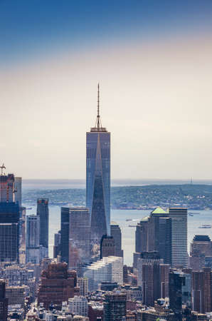 The One World Trade center or Freedom Tower located in New York City. Architectural modern buildings at lower Manhattan skyline in United States of America