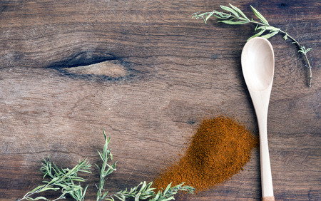 aphrodisiac: Ground pepper on wooden background Stock Photo