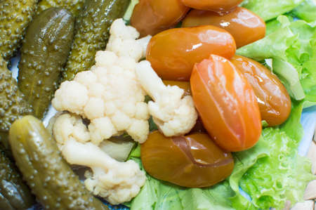 Pickled vegetables on the plate. Assorted food