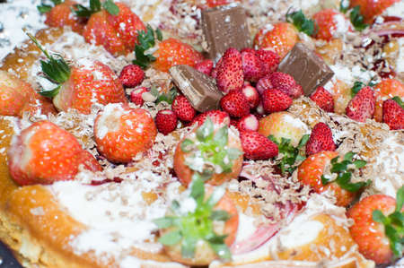 Pie with chocolate and fruit-raspberries andsweet strawberries