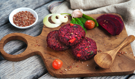 Vegetable beetroot patties before cooking with various vegetables, mushrooms, avocado guacamole and herbs to a veggie burger. Concept of healthy organic food. Top view