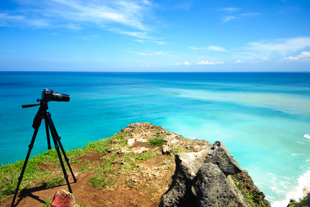 camera on a tripod to shoot amazing seascape view from the high Stock Photo