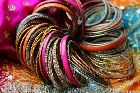Indian bracelets on beautiful shawl. Indian fashion
