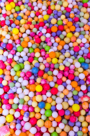 sweet shop: Mixed colors candies for sale mixed into pot Stock Photo