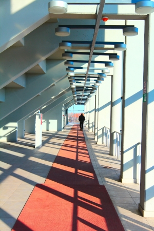 Man walks down the hall in sports center photo