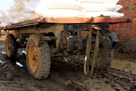 trailer loaded with bags stuck in the mud photo