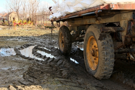 laden: trailer loaded with bags stuck in the mud