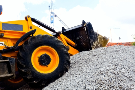 Bulldozer sitting on job site where it is used for clearing gravel for the foundation of a new building. Stock Photo