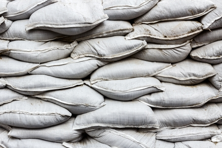 White sandbag bags are full with sand in wall formation and ready for defense