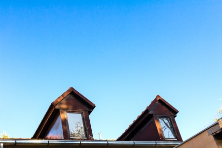 dormer: Dormer windows and rooftop of old home  Architectural details  Sky  Space for text
