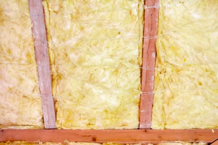 glasswool: The roof of new house is being installed with environmentally friendly and energy efficient thermal insulation