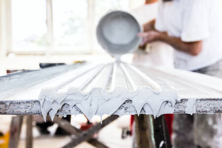 Craftsmen made plaster moldings on the traditional method