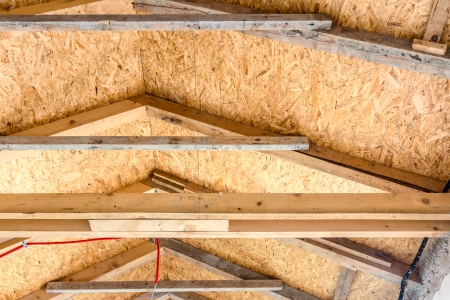 The roof of new house is being installed with environmentally friendly and energy efficient thermal insulation. Standard-Bild