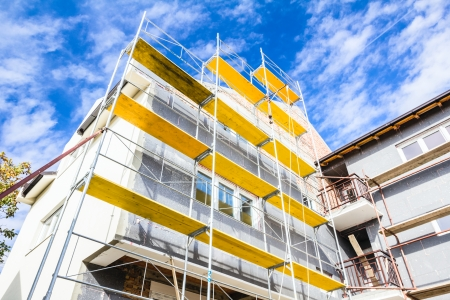 house facades: Empty workplace on scaffolding at big house. Stock Photo