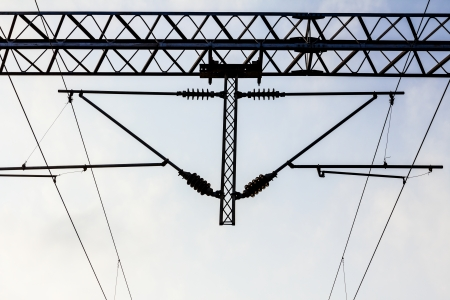 Electric holders on railway transmission line with a blue sky