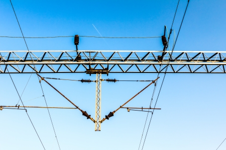 Electric holders on railway transmission line with a blue sky photo