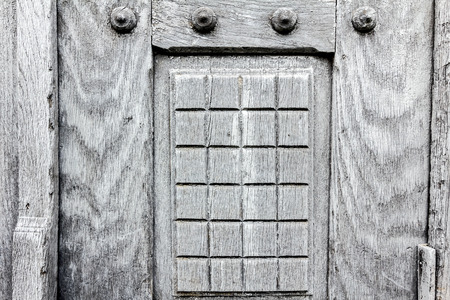 Close-up image of a hardwood gray door, showing texture. photo