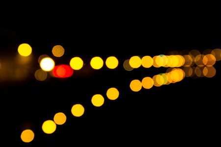 nightspot: Night defocused lights near the water in a long perspective