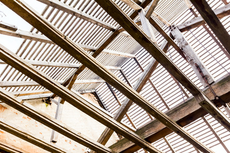 roof framing: Roof reconstruction with wood framing and trough roof trusses to the sky Stock Photo