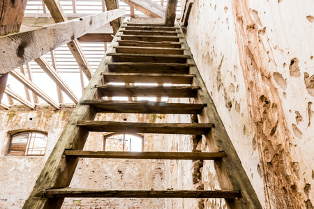 property ladder: Roof reconstruction with wood framing and trough roof trusses to the sky Stock Photo