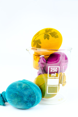 Decorated Easter eggs in a lab glass, new technologies in old\ customs