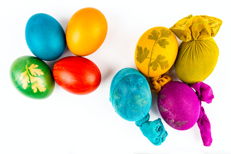 without clothes: Two groups of Easter eggs, with and without clothes Stock Photo