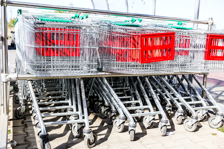 supermarket series: Series of parked shopping carts in a row in front of a supermarket