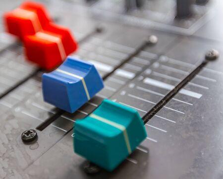 Sound studio adjusting record equipment, music mixer