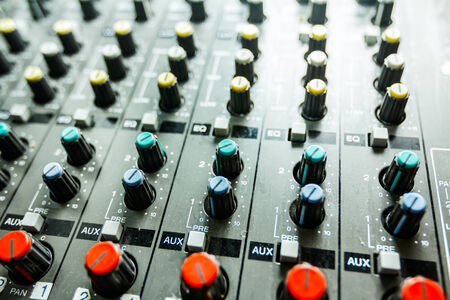 Sound studio adjusting record equipment, music mixer photo