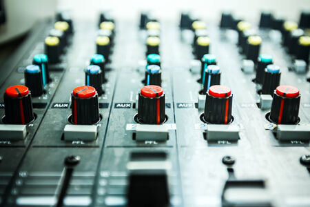 Sound studio adjusting record equipment, music mixer photo