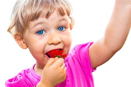 eat smeared: Blue-eyed, 3 year old girl smeared around mouth  Stock Photo