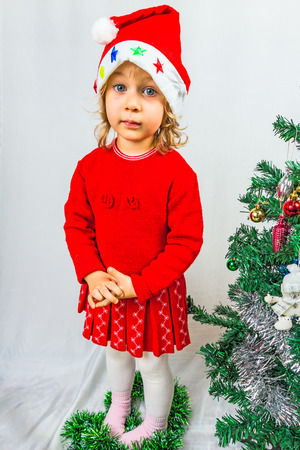 Blue-eyed, 3 year old girl in red dress photo