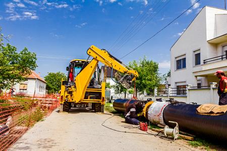 Work is in progress, welding pipeline in urban area  photo