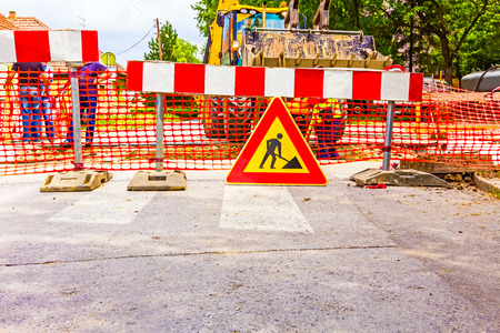 Road signs in a street, under reconstruction symbol Stok Fotoğraf - 31089888