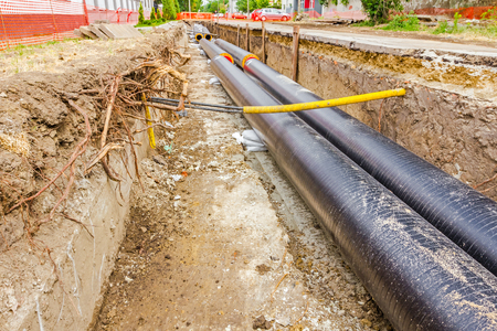 new building construction: New pipeline in the process of building, under construction Stock Photo
