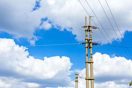 tangling: View on electrical power line with cloudy sky in the background.