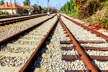 replaced: Old wooden sleepers replaced with new made of concrete sleepers on the railway track. Stock Photo