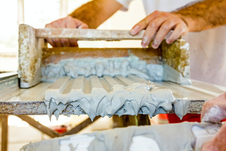 moldings: Craftsmen made plaster moldings on the traditional method