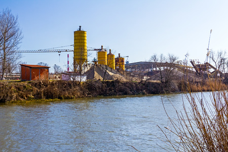 gravel pit: Gravel pit with a several silos and belts along with large piles of various grades of gravel