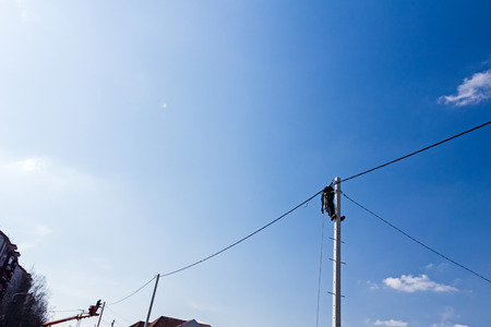 skilled operator: Technician works high up on a power pole