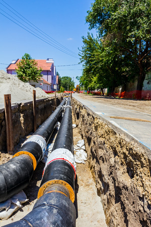 struts: Long earth excavation for new pipeline is protected by iron shuttering.