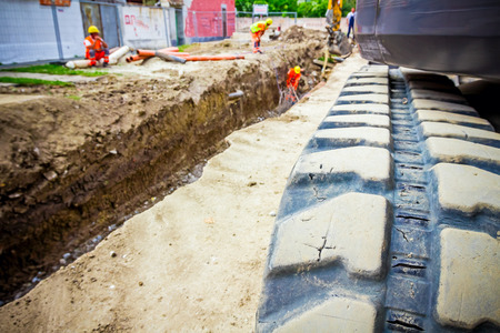 crawler: Excavator crawler belt close up in construction site. Stock Photo